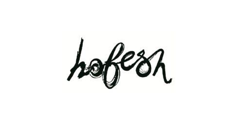 hofesh in black painted handwriting.