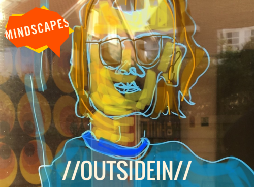 A close up squiggly drawing of a face. The face is yellow, and they have blue sunglasses and a blue shirt. The picture appears to be drawn on a window. We can;t see what's behind the window.