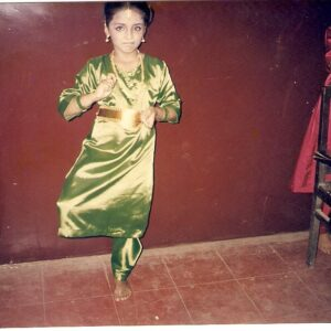 Jolene as a child in Classical Indian Dance pose