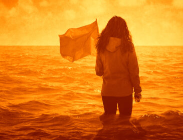 The Poster for Extinct, a young woman stands in the shallows of the ocean, looking out at the sea with a flag