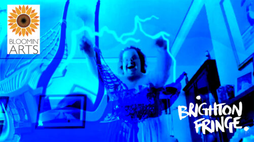 An photo in hues of blue of a person stood in a living room with their arms raised. There is lightening around their arms.