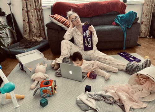 photo of mother and baby in pyjamas on the floor of a living room