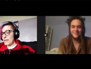 White non-binary person with purple hair on a zoom call with a mixed-race man with dreadlocks