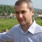 portrait photo of a white male pictured in the countryside