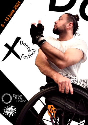 There is a man sitting in a wheelchair and he is looking behind and up to the corner where there are the dates of the festival and the X dance festival logo.