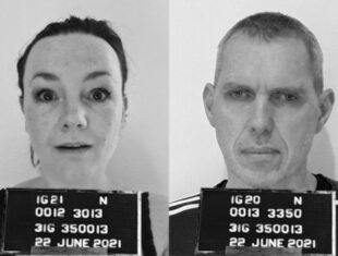 Black and white image – two mugshots side by side. On the left a white woman with scraped back hair and surprised expression. On the right a white man with short hair and a moody expression. Code letters and numbers and a date on boards by their chests