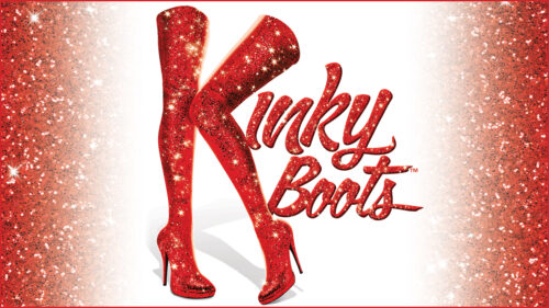 Kinky Boots in red sparkly text on a white and red background. The K is styled from a pair of red thigh high boots.