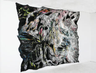 A large abstract artwork hanging on a gallery wall.