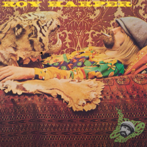 album cover from the 1960s of a white man reclining on a sofa