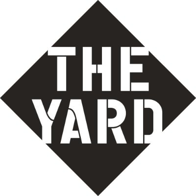 The Yard in white bold capitals within a black diamond.