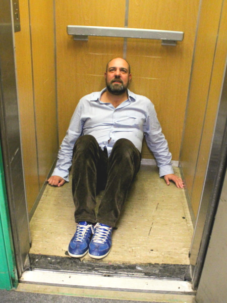 photograph of James Paddock in an elevator