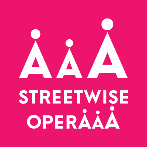 3 white A's each with a dot above, above white capital text that reads: Streetwise Operaaa. The three a's in opera have dots above. All on a pink background.