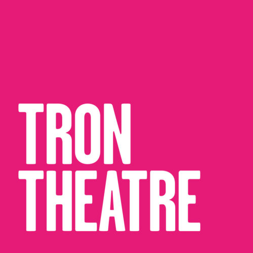 Tron Theatre in white capital text on a hot pink square background.