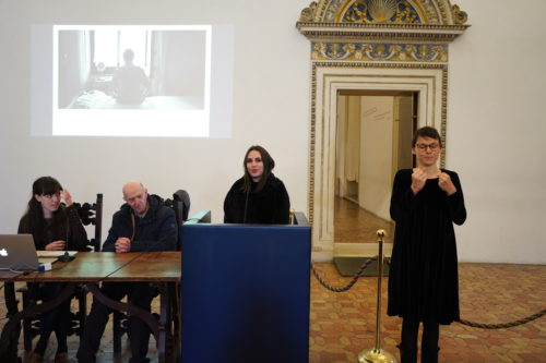 Prize giving event in the Ducal Palace, Urbino, Italy, with first Prize winner and Sign Language interpreter