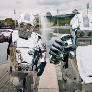 photo of two performers dressed as silver robots