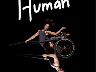 A woman and man swing from a trapeze, the woman kneeling on the man who is in a wheelchair. Human is written above them in white letters, contrasting with the black background