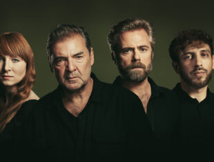 Image of four actors all wearing black staring straight ahead with blank expressions.