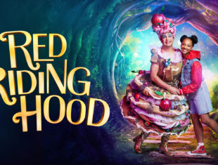A pantomime dame stands next to a young black girl wearing a denim dress and red hoodie. To the left gold capital text reads: Red Riding Hood.