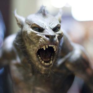 Close up photograph of a snarling werewolf figurine