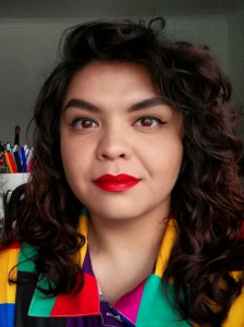 Headshot of a woman of colour wearing bright red lipstick