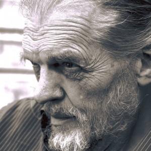 Sepia headshot of an older white man