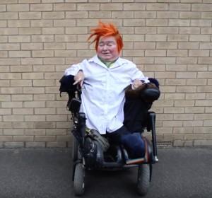 a wheelchair-user with orange hair