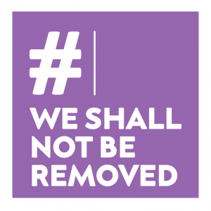 purple logo which reads we shall not be removed